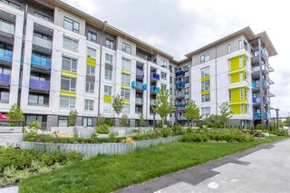 """Photo 1: 101 3289 RIVERWALK Avenue in Vancouver: South Marine Condo for sale in """"R+R"""" (Vancouver East)  : MLS®# R2463417"""