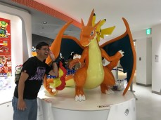 Pikachu riding a Mega Charizard Y! Various parts of the statue are signed by the creators.