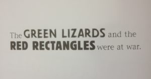 Page of a book saying the Green Lizards and the Red Rectangles were at war