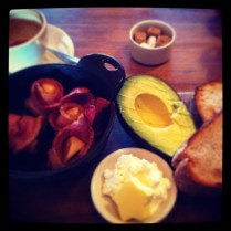 Amazing breakfast - fruit toast, avocado, cottage cheese and apple wrapped in bacon.