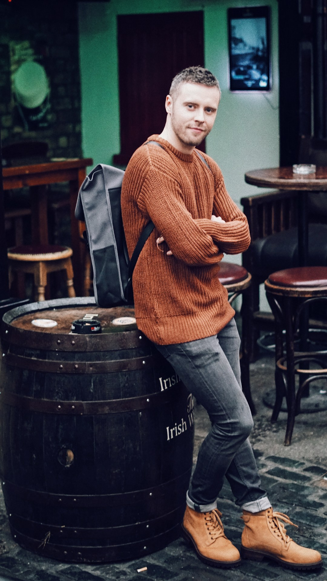 The Mighty Craic. Wearing knit jumper from H&M, boots from Zara, jeans from All Saints and backpack from RAINS. Shot at The Brazer Head pub in Dublin, Ireland.