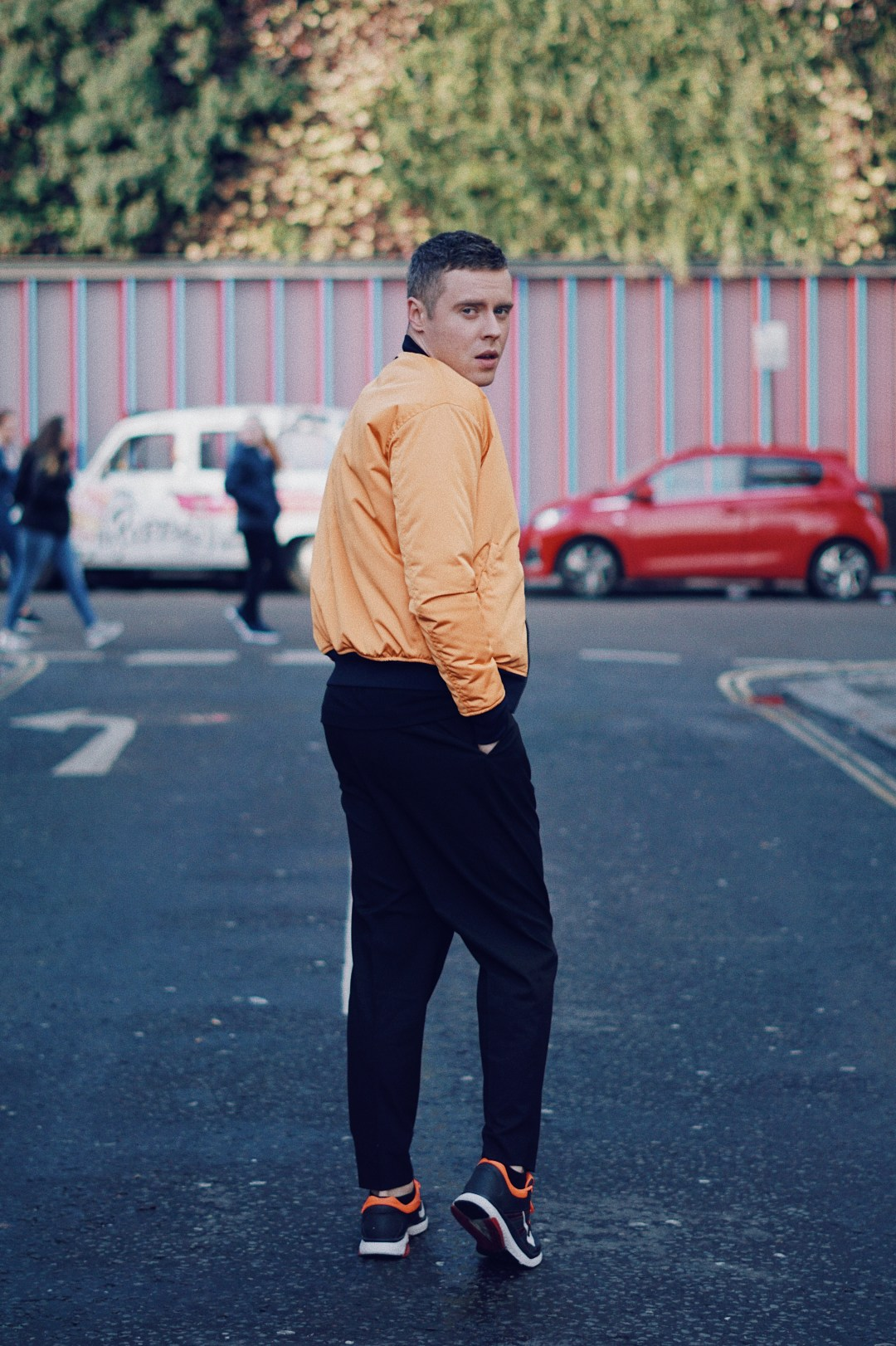 Wearing Padded Neon Bomber Jacket from Zara, Multi Helmet T-shirt from Billionaire Boys Club, Drop Crotch Trousers from ASOS and Trainers from Nike. Shot in Camden Town, London.