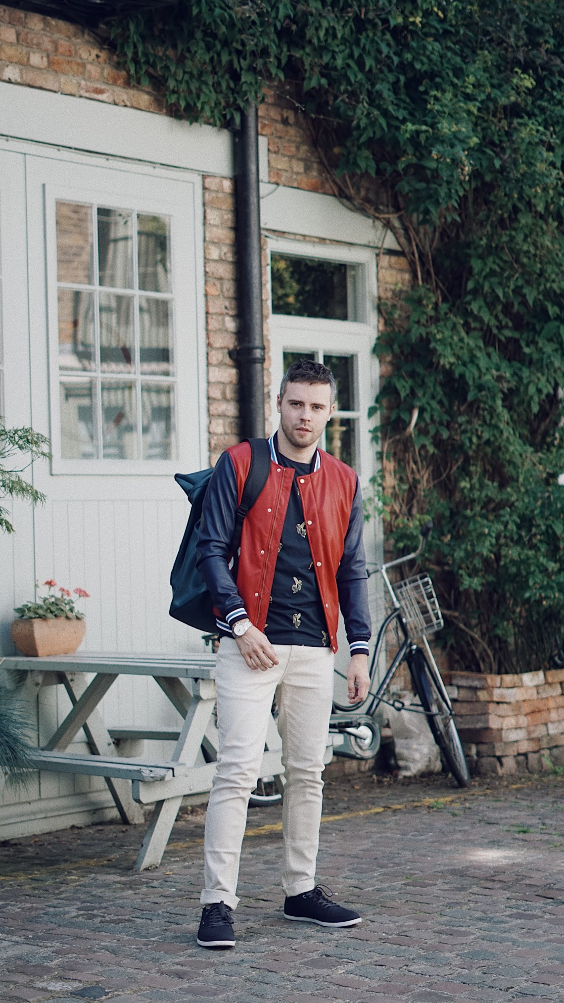 St Lukes Mews in Notting Hill. Wearing KRONABY Sweden Sekel Watch, Zara College Bomber Jacket and Printed Top in Navy Blue, PrimarkStone Twill Stretch Skinny Trouser and Boxfresh Shoes. Snapped by Ed Lemon from The Discerning Man. Blog by Skirmantas Petraitis
