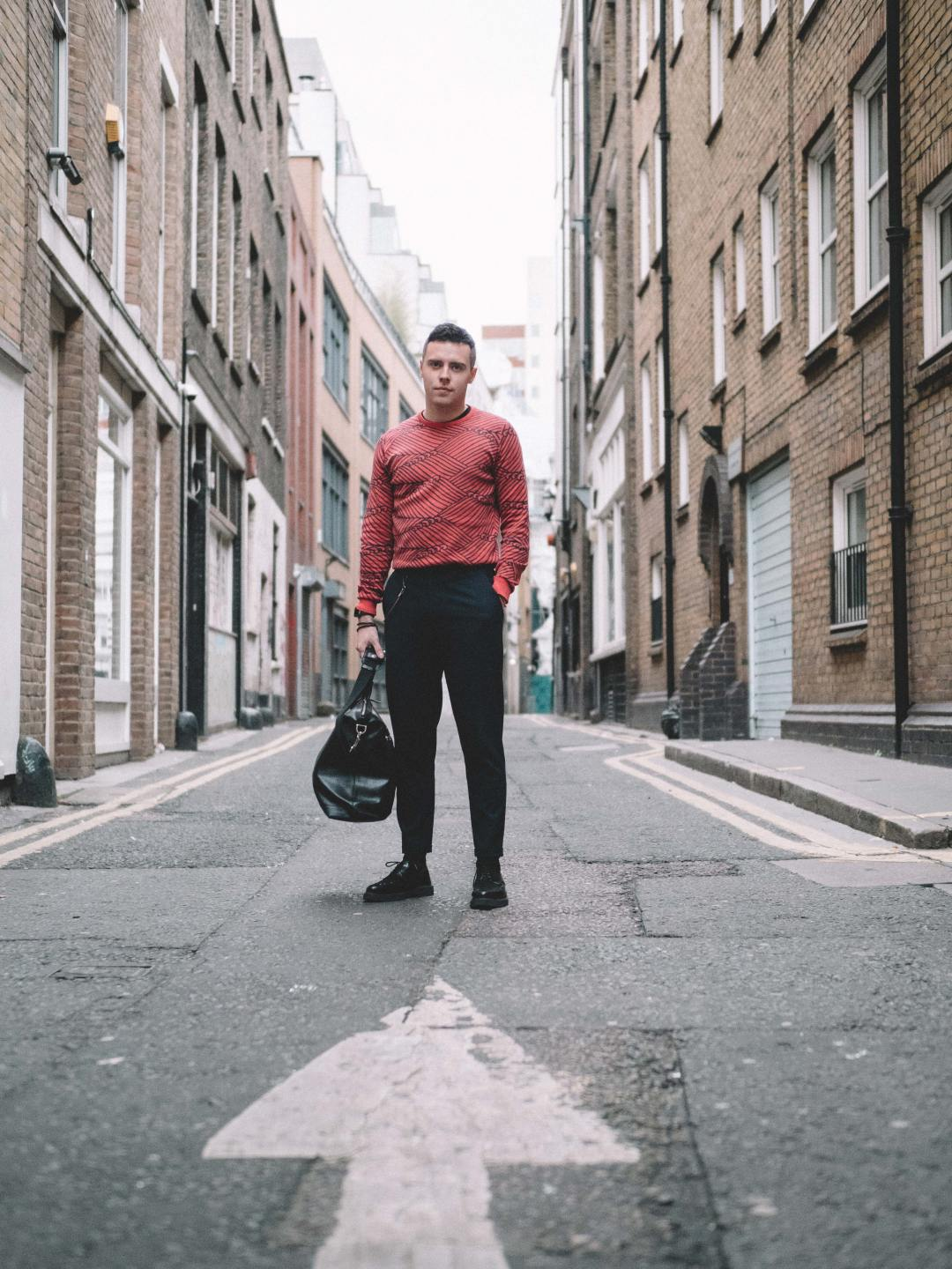 John Smedley's Seaham in Ruche Red/Flannel Grey, crafted from a sumptuous fine knit Sea Island Cotton. Also wearing The Anderson Tote in Black from Aspinal of London. Shot by Mervin Kaye. Blog by Skirmantas Petraitis.