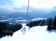 Catching a ski lift down the slopes in Zakopane, Poland