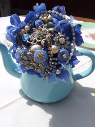How about bouquets in a teapot for your centre pieces?