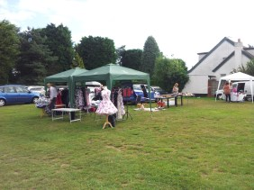 Lots of stalls outside, one with big dresses!