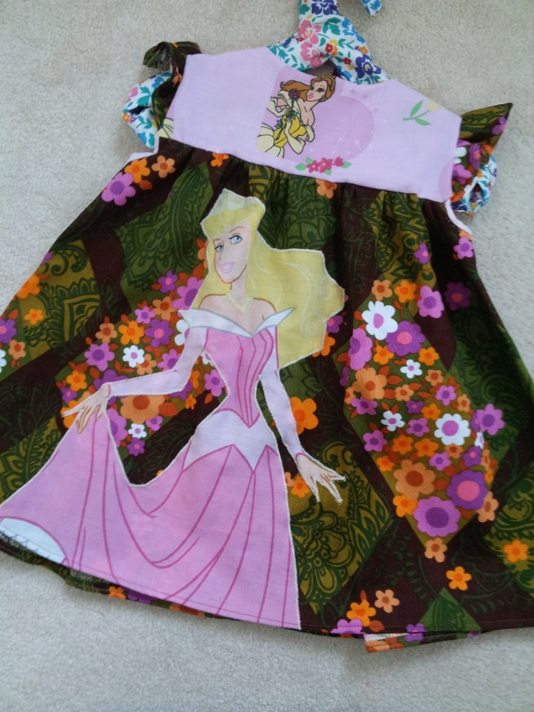 How could you not want a dress with Cinderella on?