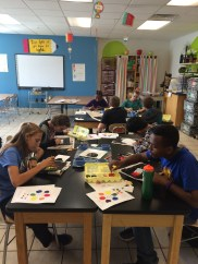 8th grade mixing paint for their color wheels.