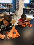 Kindergarten and First Grade adding the element of line to their positive & negative pumpkins.