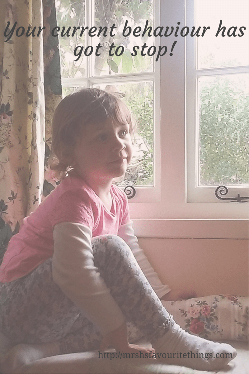 A little girl, looking all sweetness and light, sitting on a window seat and starring into the distance with the title_Your current behaviour has got to stop!_Mrs H's favourite things