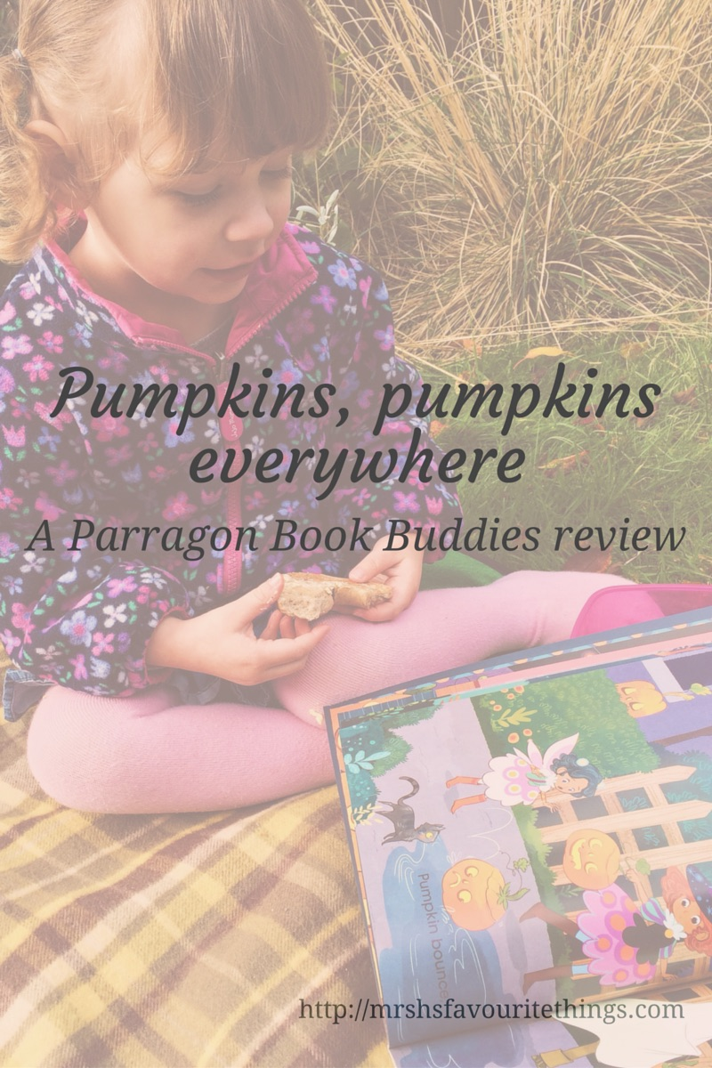 "A little girl sitting on a rug in the garden on an autumnal day eating a bagel and reading the book ""Pumpkins, pumpkins everywhere"" with the blog post titie_Pumpkins pumpkins everywhere_a Parragon Book Buddies review_Mrs H's favourite things"