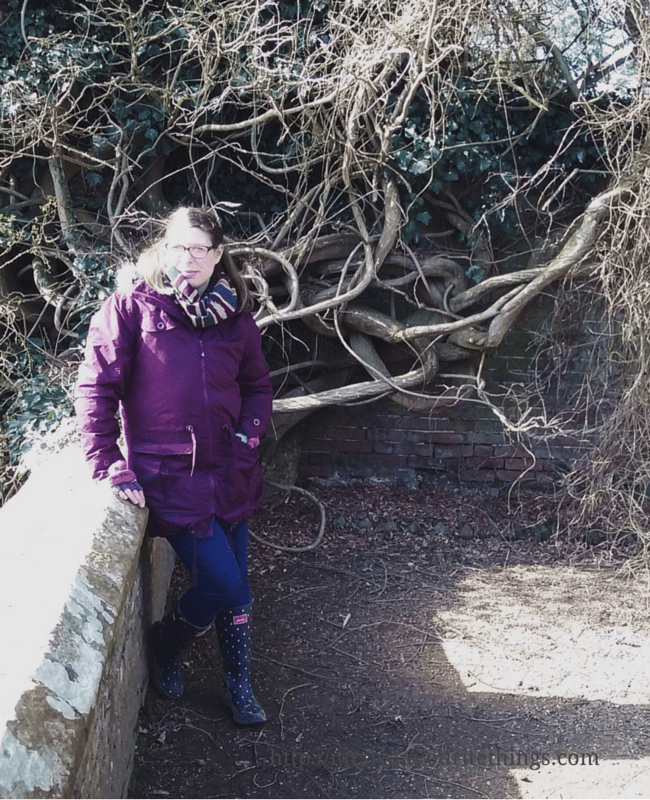 A faded photograph of a pregnant lady dressed in cold weather gear, standing by a brick wall near the moat at Groombridge Place with a knarled and knotted tree in the background _ A perfect Mother's Day _ Mrs H's favourite things