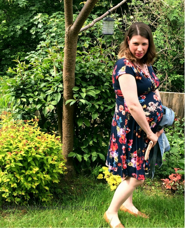 A photograph of a pregnant lady standing in a garden wearing a floral maternity dress from Tiffany Rose _ What I wore ... for afternoon tea at the Savoy ... when 32 weeks pregnant _ Mrs H's favourite things