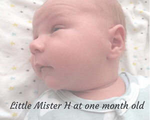 "A faded photograph of a one month old baby boy wearing a Bamboo Bunny Romper from Bambini & Me and lying on a white blanket covered in tiny yellow, green and grey stars_ with the title ""Little Mister H at one month old"" - Mrs H's favourite things"