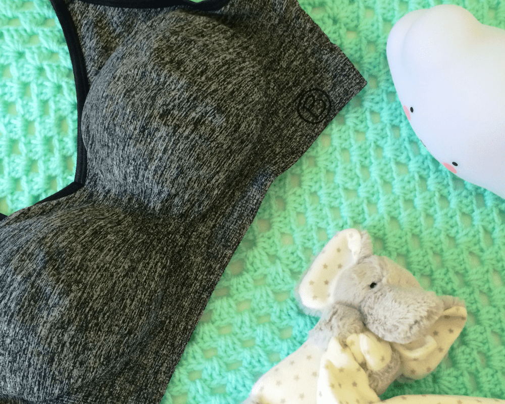 A photograph of the Bravado Body Silk Seamless Yoga Nursing Bra in Charcoal Heather - lying on a green blanket - next to a small cloud nightlight and an elephant soft toy soother - Bravado's body silk seamless yoga nursing bra - a review - Mrs H's favourite things