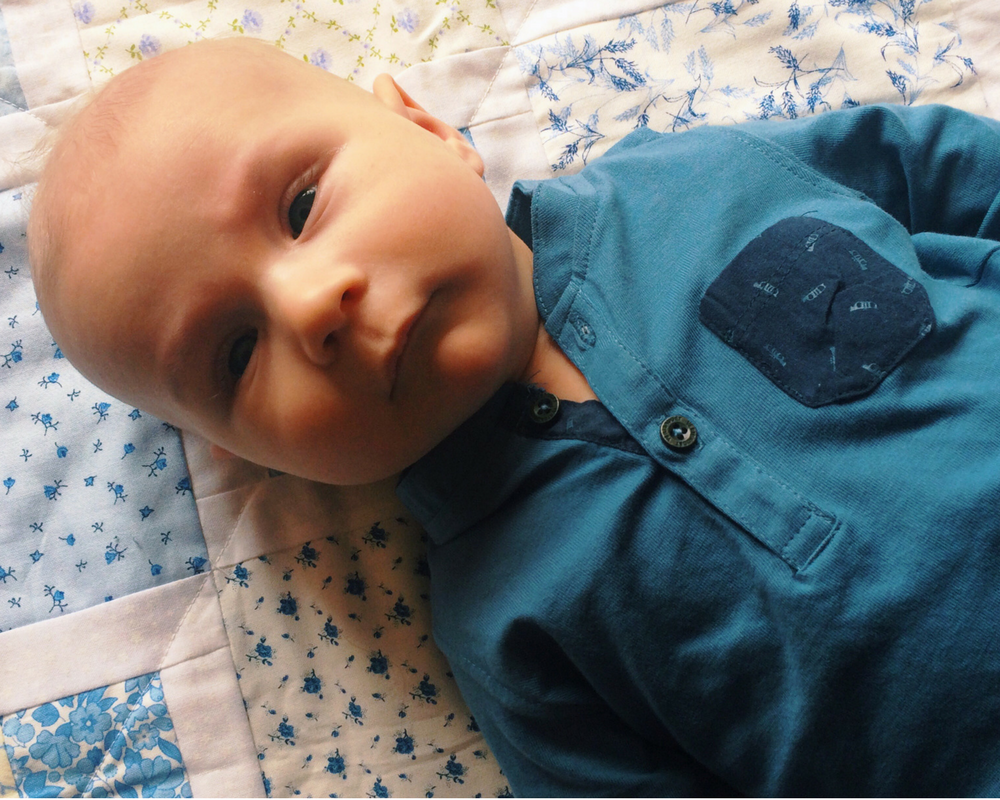 A photograph of a three month old boy wearing a long sleeved grandad style t-shirt in petrol blue - The perfect capsule wardrobe for kids from Vertbaudet_Mrs H's favourite things