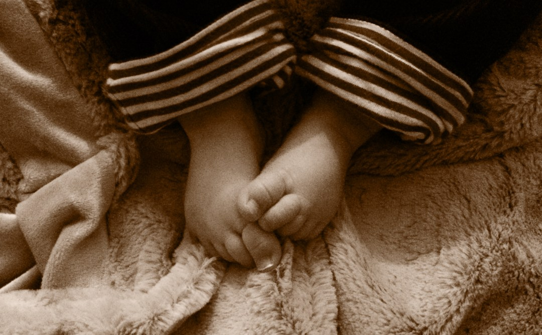 A sepia tinted photograph of a young baby's feet and toes - A open letter to our first baby - Mrs H's favourite things