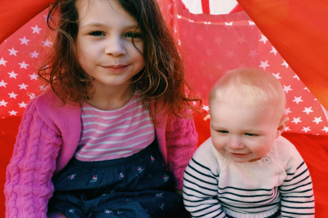 A photograph of two children, a little girl and her baby brother, sitting inside a tee pee and looking cheekily at the camera - To my children on mothers day - Mrs H's favourite things