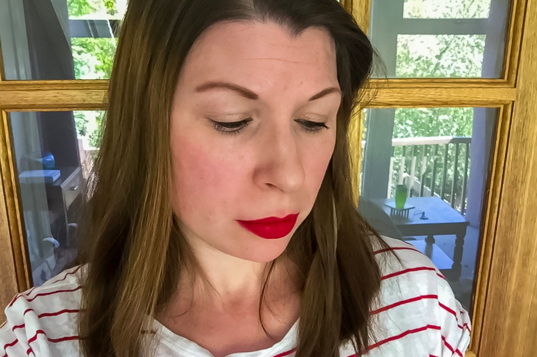 A photograph of a woman with brown hair, wearing a stripey t-shirt and bright red lipstick - Living With Depression: Having A Nervous Breakdown & Being Given A Diagnosis - Mrs H's favourite things