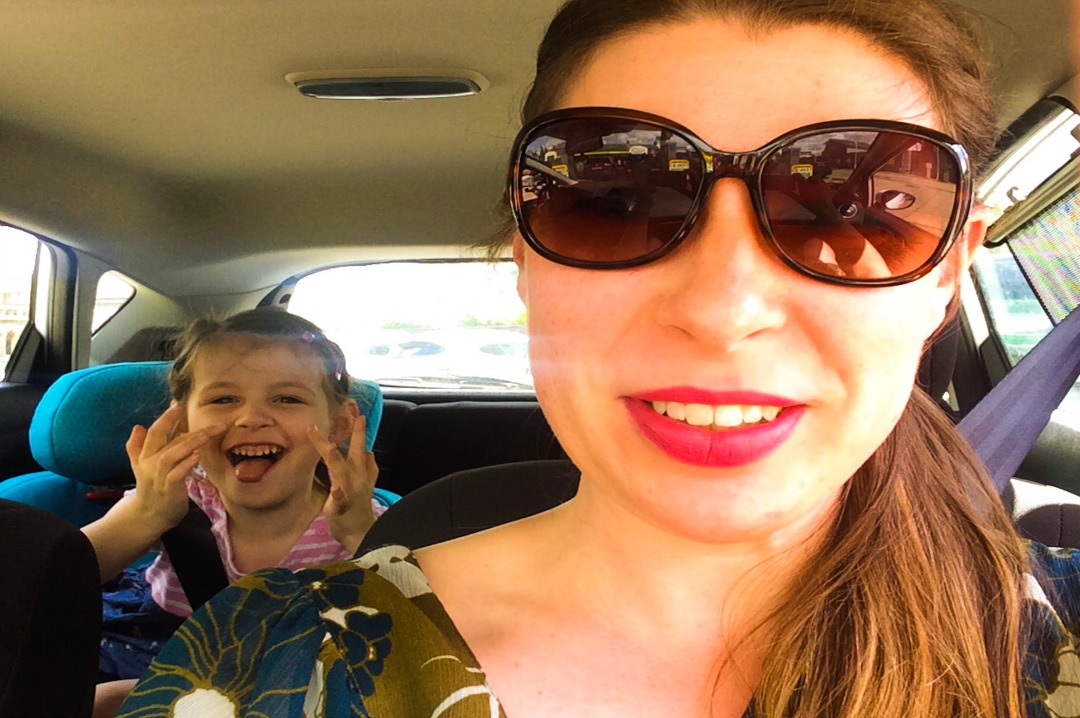 A photograph of a mum and a little girl in a car looking excited before they go to see In The Night Garden Live in Blackheath - In The Night Garden Live - a review - Mrs H's favourite things