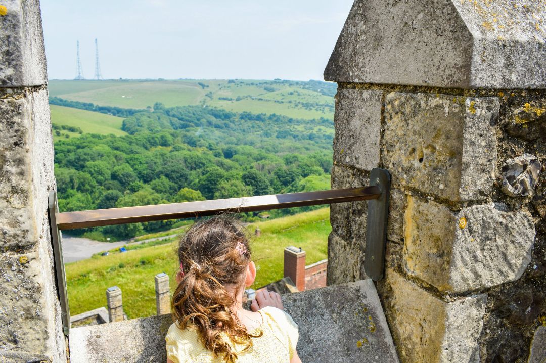 A photograph of a little girl peering over the edge of the Great Tower at Dover Castle to look at the view - a Day At Dover Castle with the Quinny Zapp Flex Plus - Mrs H's favourite things
