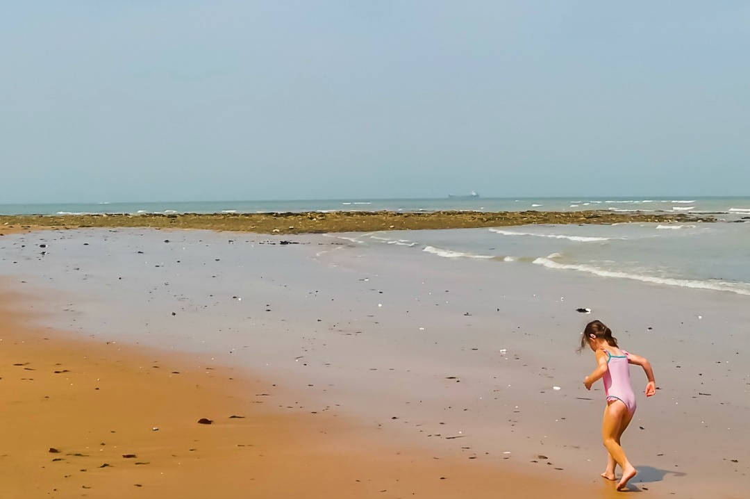 A photograph of a little girl playing in the shallows of the sea at Botany Bay in Broadstairs, Kent- Our Week in Broadstairs - Mrs H's favourite things