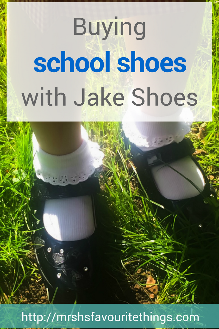 "A photograph of a little girl's first ever pair of school shoes which are from the website Jake Shoes and a pair of black patent Lelli Kelly School Shoes featuring the text ""Buying school shoes with Jake Shoes"" - The First pair of school shoes with Jake Shoes - Mrs H's favourite things"