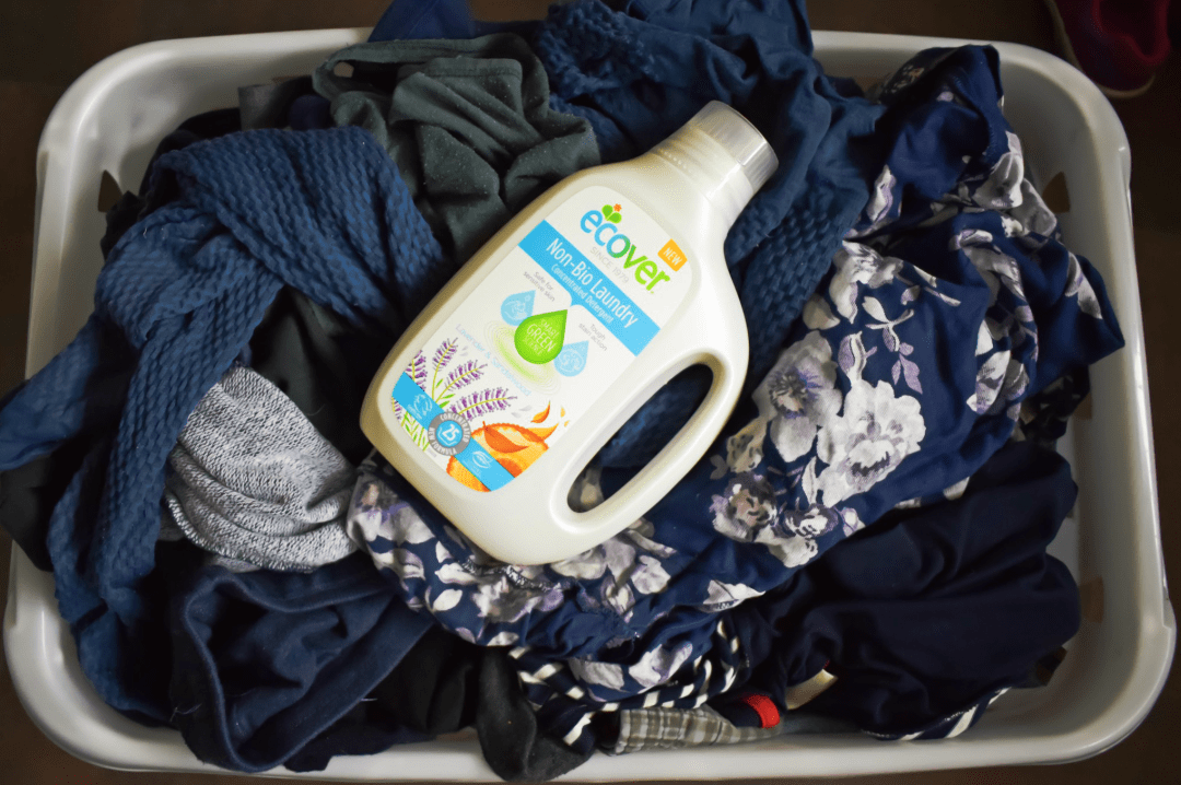 A photograph of some clean laundry in a white laundry basket with a bottle of Ecover Non-Bio Concentrated Laundry Liquid on top - Showing Our Laundry Some Love with Ecover and the #EcoverLaundry Challenge - Mrs H's favourite things