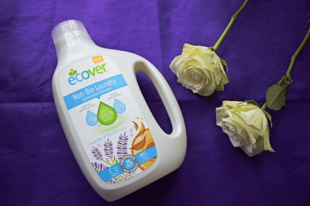 A photograph of a bottle of Ecover Non-Bio Concentrated Laundry Liquid on a piece of purple felt with two white roses next to it - Showing Our Laundry Some Love with Ecover and the #EcoverLaundry challenge - Mrs H's favourite things