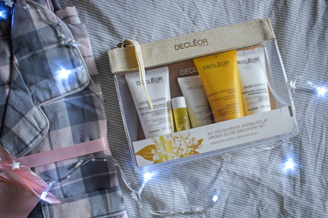 A photograph of a new pair of checked grey and light pink pyjamas and a pack of Decleor beauty goodies - 5 Steps to the Perfect Pamper Night with Simply Be - Mrs H's favourite things
