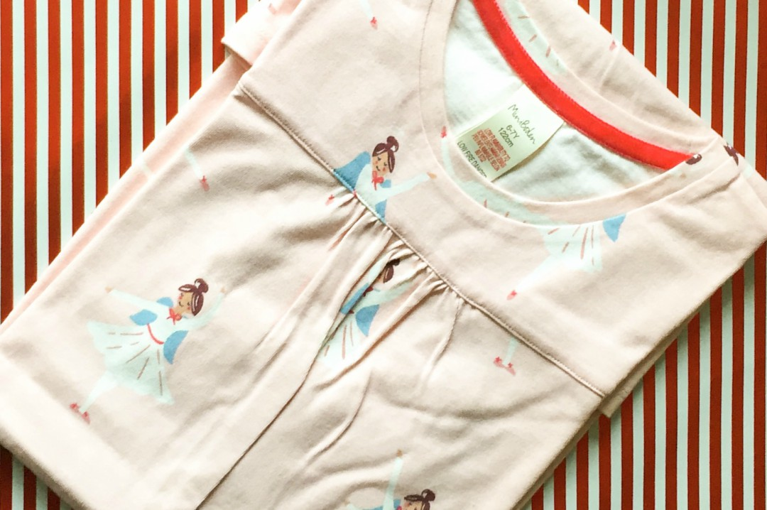 A photograph of a nightie from Mini Boden - the nightie is pale pink and is covered in Christmas fairies - Our Christmas Eve Box - what's inside? - Mrs H's favourite things