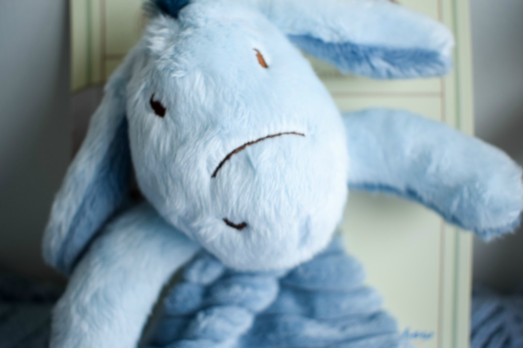 A close up photograph of the face of the Eeyore Comfort Blanket from the Classic Pooh collection by Rainbow Designs Ltd - Rainbow Design's Classic Winnie the Pooh Toys - A Review and Giveaway - Mrs H's favourite things