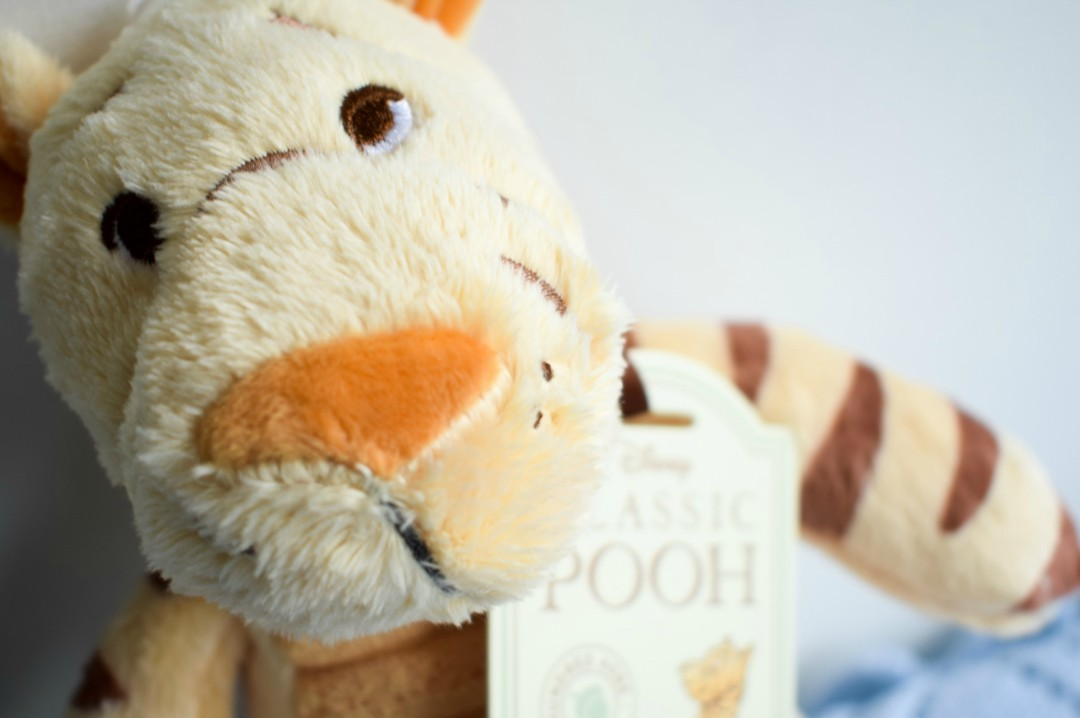 A close up photograph of the face of the Tigger Soft Toy from the Classic Pooh collection by Rainbow Designs Ltd - Rainbow Design's Classic Winnie the Pooh Toys - A Review and Giveaway - Mrs H's favourite things