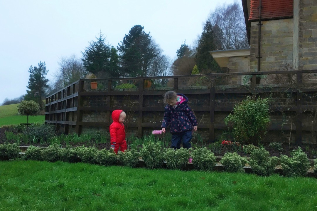 A photograph of a four year old girl and her baby brother jumping in muddy puddles at Standen House and Gardens - Our Weekend Happy #2 - Pampering, pyjamas ad muddy puddles - Mrs H's favourite things