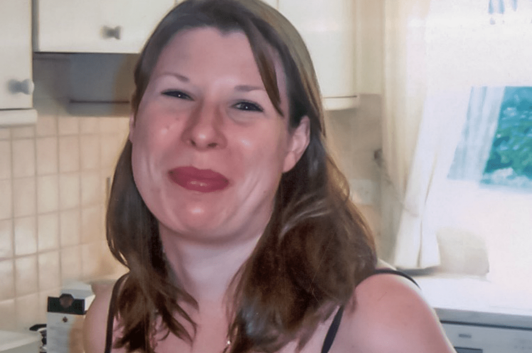 A photograph of a young brunette standing in her kitchen and smiling - Antidepressants and Me - My Story of Taking Antidepressants - Mrs H's favourite things