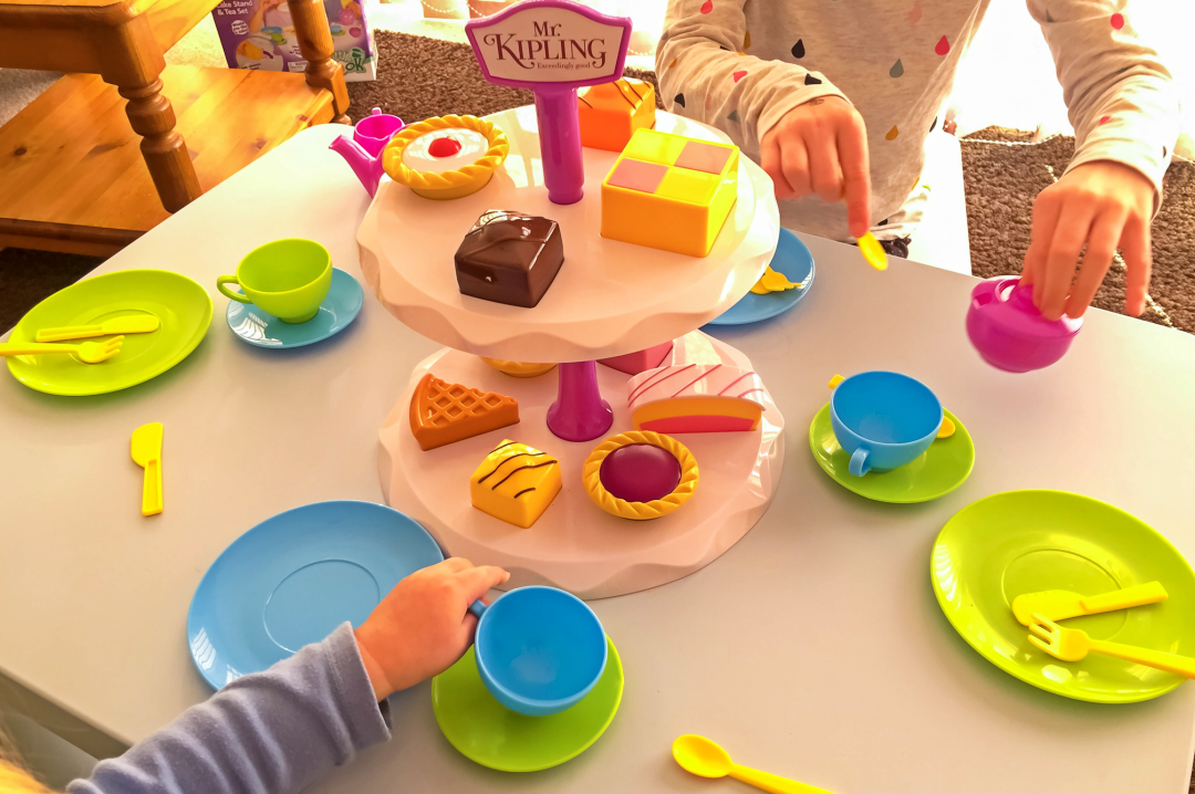 Two kids playing tea parties at home - Fun Things To Do In The Easter Holidays - Mrs H's favourite things
