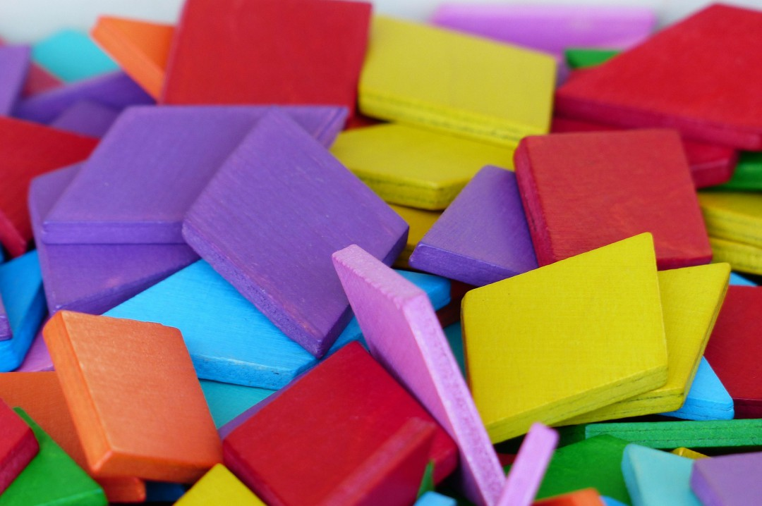 A photograph of colourful toy wooden blocks - Creating A Positive Learning Environment For Your Kids - Mrs H's favourite things
