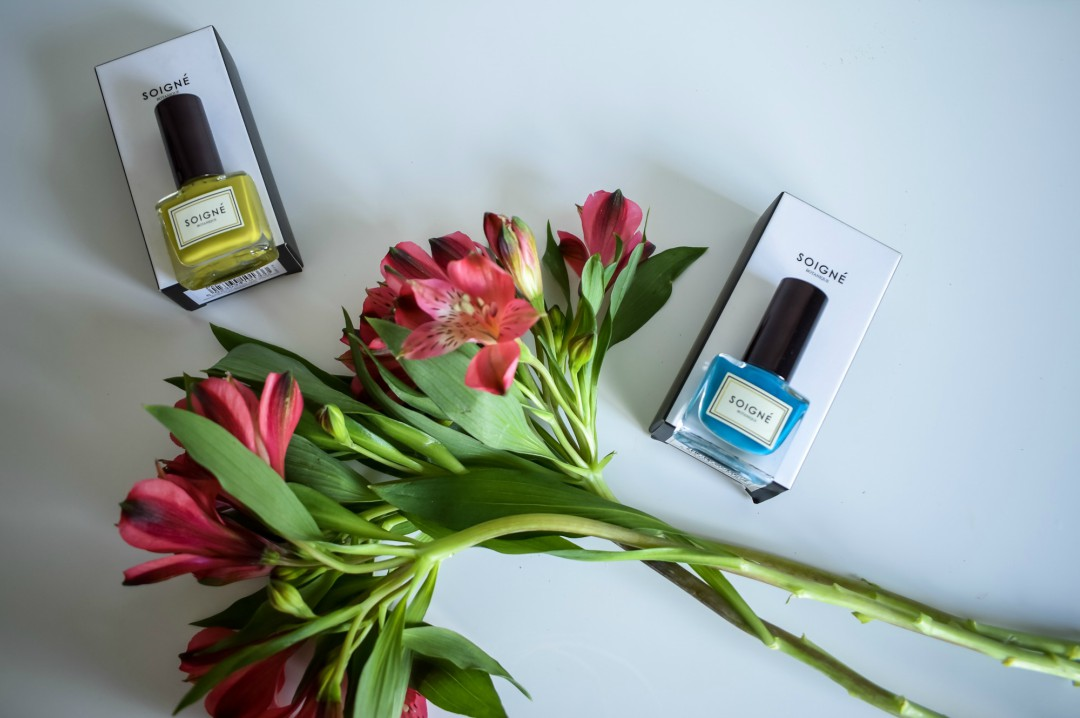 A photograph of two nail colours from Soigne - Vodka Bleu and Papillion De Nuit and some flowers - Mother's Day Gift List - Treats for the Mother in your Life - Mrs H's favourite things