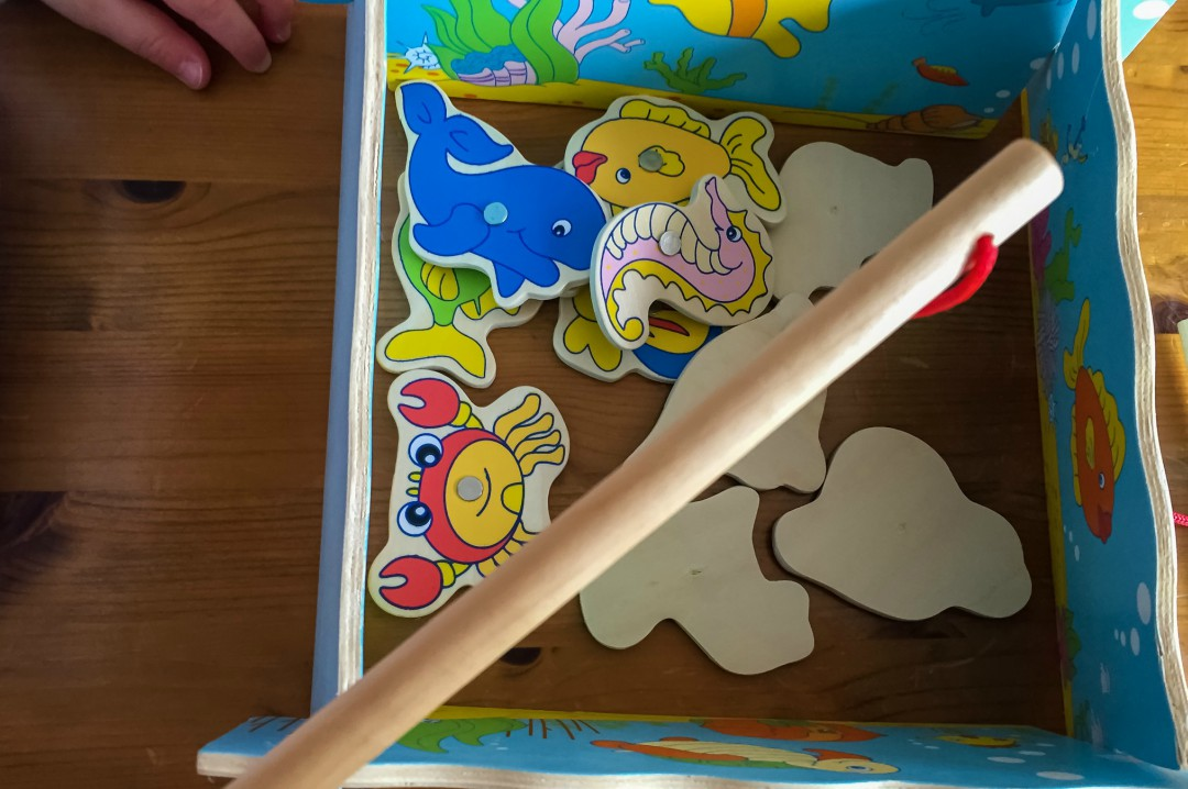 A little boy's hand and the Bigjigs magnetic fishing game - Our Weekend Happy #9 - Seeing Grandparents, A Lie In & A Lovely Mother's Day Lunch - Mrs H's favourite things