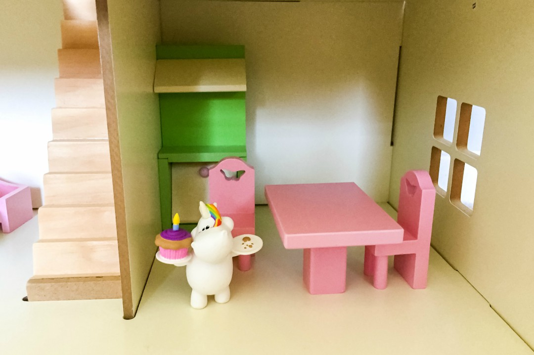 A photograph of one Bullyland Chubby Unicorns who has begun to live in a little girl's dolls house - Bullyland Chubby Unicorn Figurines - A Review - Mrs H's favourite things