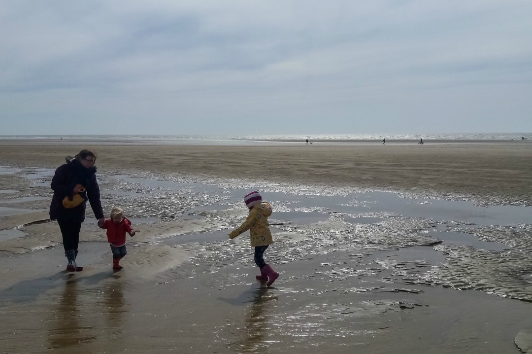 A photograph of a mother with her son and daughter at the beach in Camber Sands - Why I Want Our Children To Have Emotional Intelligence - Mrs H's favourite things