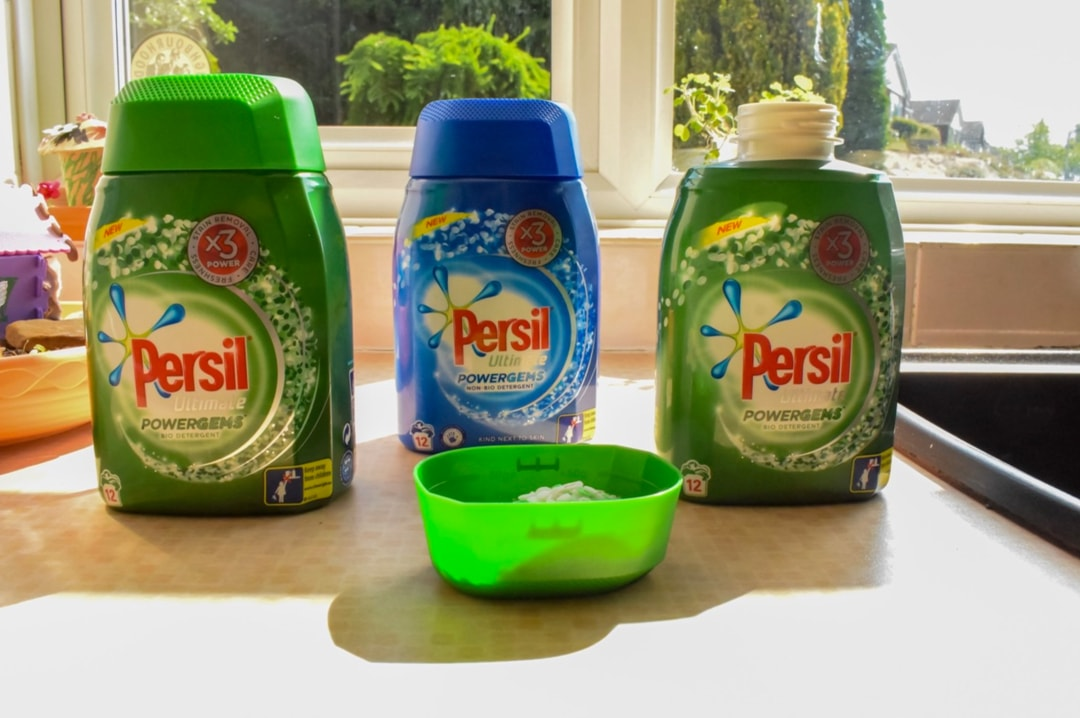 A photograph of three bottles of Persil Ultimate Powergems out on a counter in a kitchen - Sharing My Laundry Gems With Persil Powergems - Mrs H's favourite things