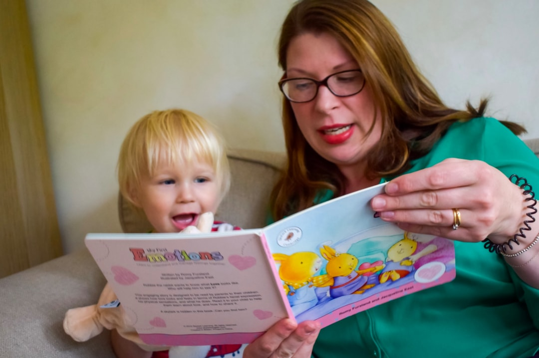A photograph of a mother and her son - the mum is reading a copy of the Love book from My First Emotions Box by Skylark Learning - The Importance Of Validating Your Children's Emotions - Mrs H's favourite things