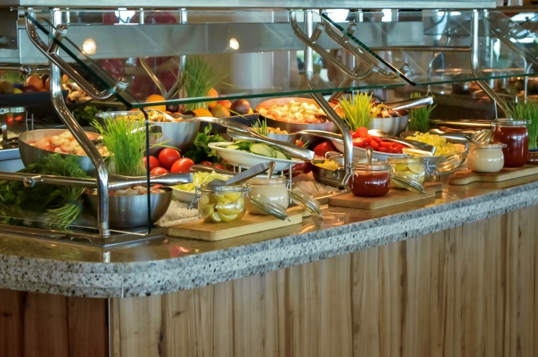 A photograph of some of the food at the Windjammer Marketplace restaurant onboard the Royal Caribbean cruise ship Independence Of The Seas - 10 Reasons Why A Royal Caribbean Cruise Would Make A Perfect Family Holiday - Mrs H's favourite things