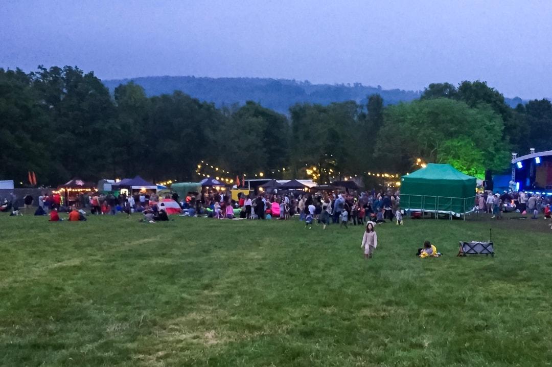 A little girl walking up a big hill at Elderflower Fields Festival - Mrs H's favourite things