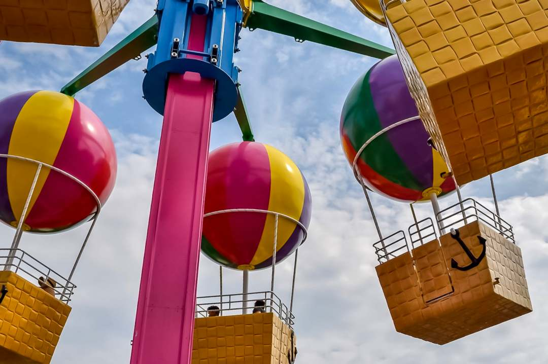 A photograph of the hot air balloons and baskets in the ride Peppa's Balloon Ride in Peppa Pig World at Paultons Park - Paultons Park and Peppa Pig World - A Review - Mrs H's favourite things