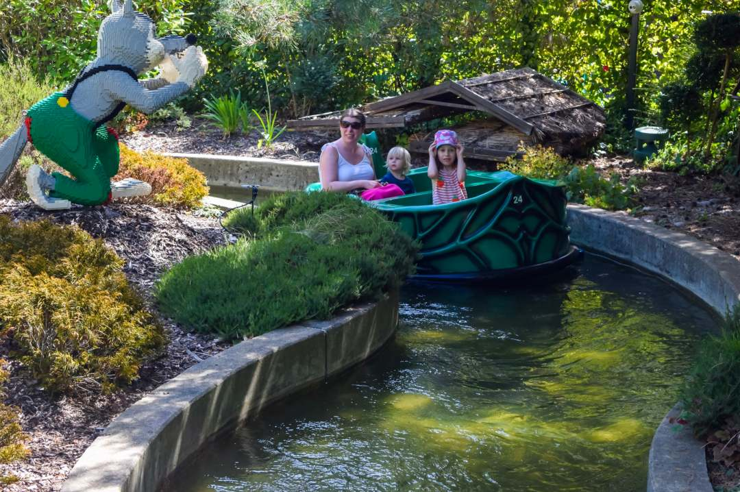 A photograph of a mother, son and daughter on the Fairy Tale Brook Ride at LEGOLAND® Windsor Resort - LEGOLAND® Windsor Resort - A Review - Mrs H's favourite things