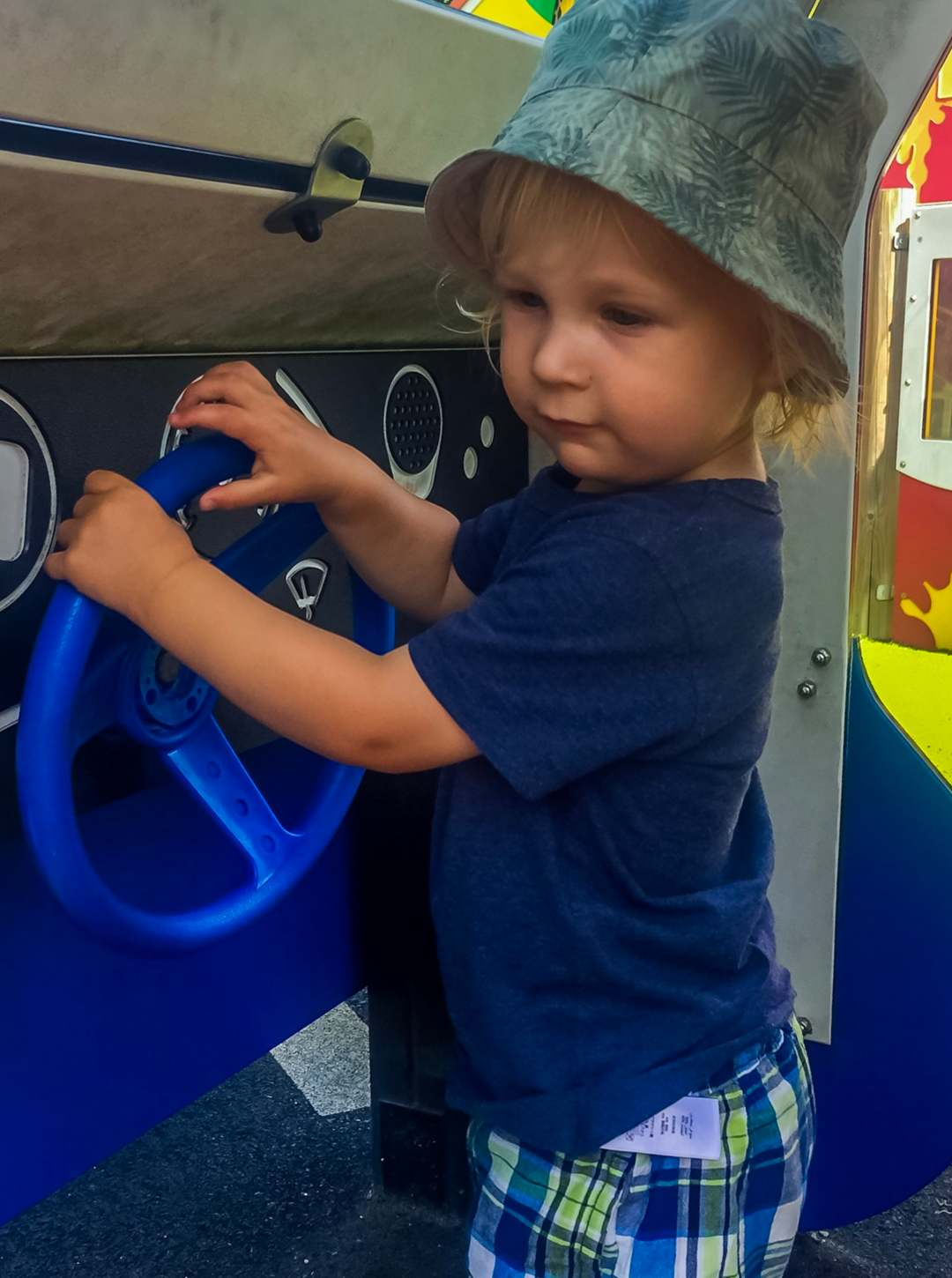 A little boy playing in then police car at Brickville which is part of DUPLO® Valley at LEGOLAND® Windsor Resort - LEGOLAND® Windsor Resort - A Review - Mrs H's favourite things