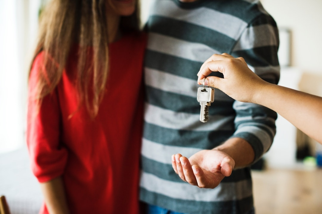 A photograph of a couple being handed their house keys - Top Ways To Improve The Value Of Your Property - Mrs H's favourite things